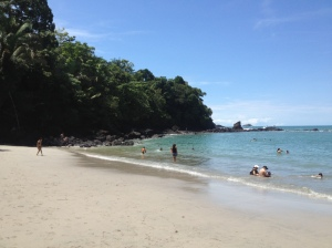 People gather at one of the most beautiful beaches in Costa Rica. Photograph by Brenda Puga